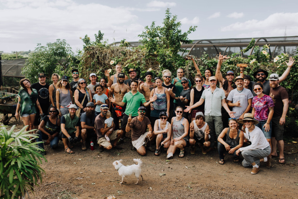 volunteer in the garden in maui, hawaii to benefit the schools and homeless shelter