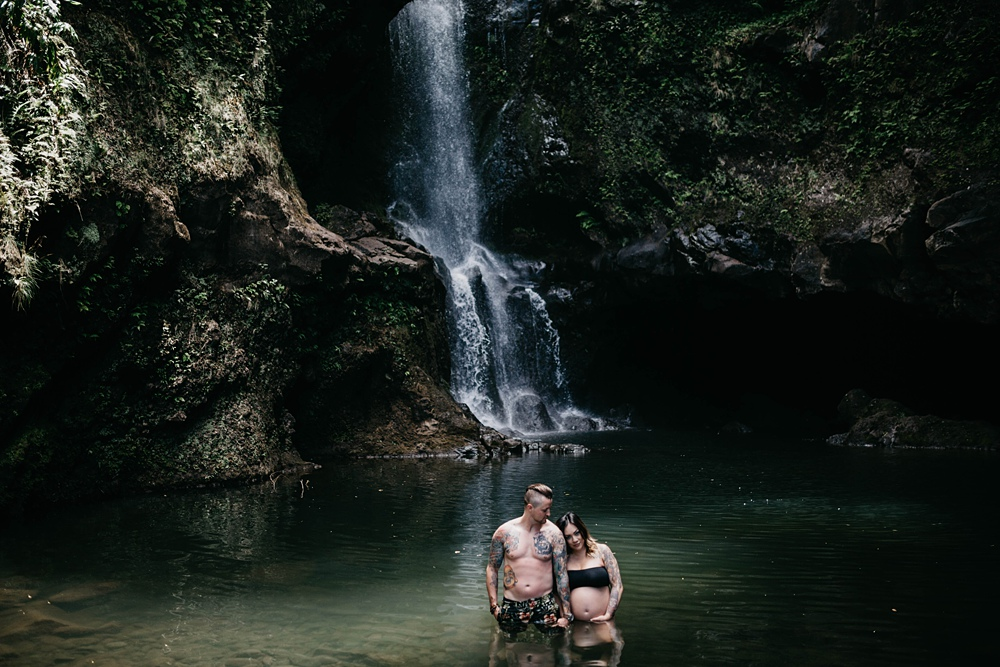 maui maternity and pregnancy photos at a waterfall on the road to hana in hawaii.
