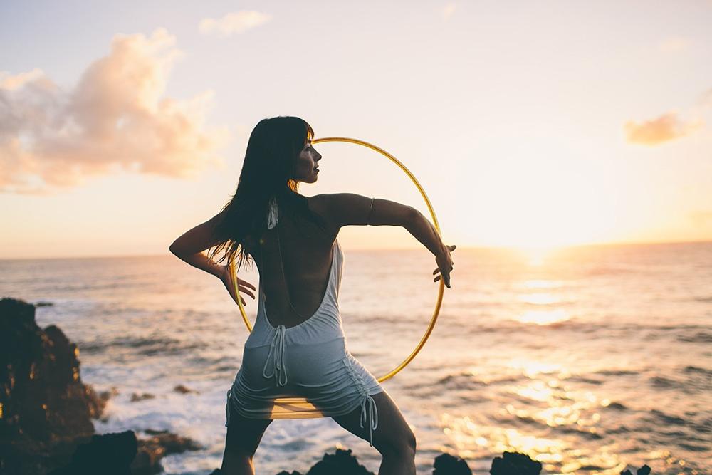 the hula hoop girl at sunrise