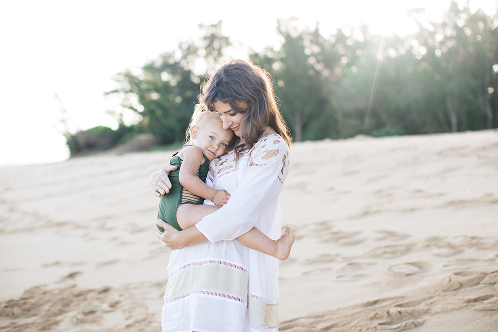 maui family photographer cadence captures a mother and daughter at Baldwin Beach in Paia.
