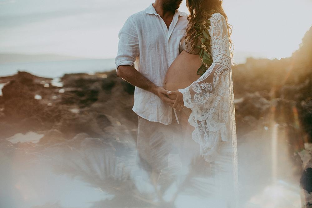 sunset maternity photographs taken at makena cove in hawaii.