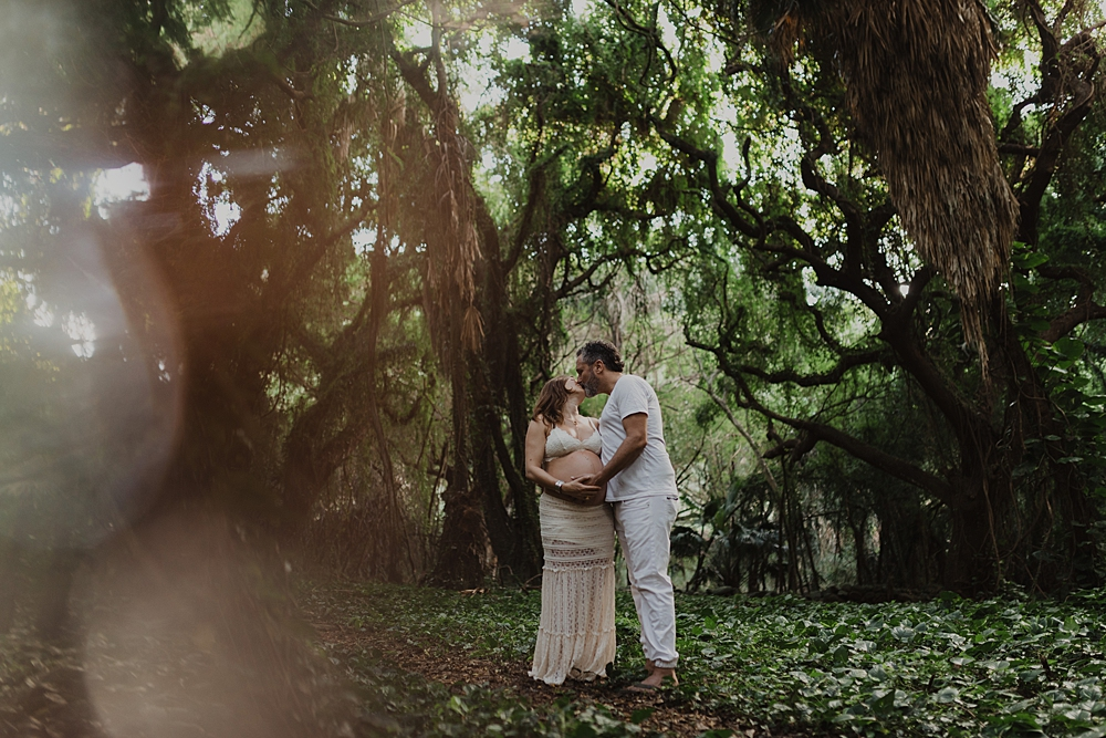 creative maternity photos in honolua forest in hawaii.