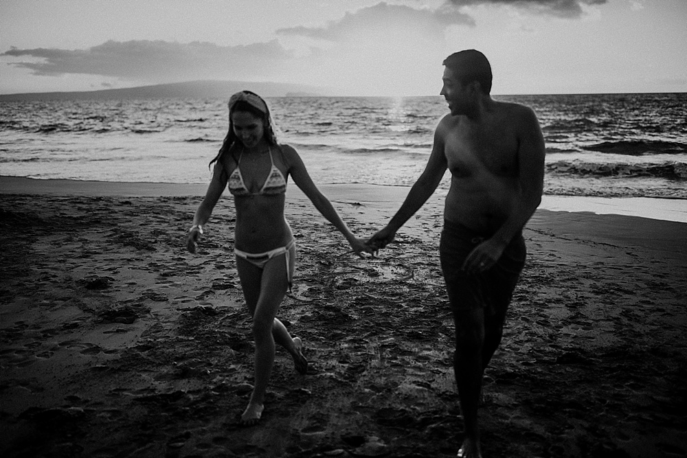 black and white photo of couple holding hands in wailea
