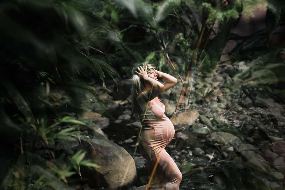 double exposure of a maternity photo in the jungle on road to hana