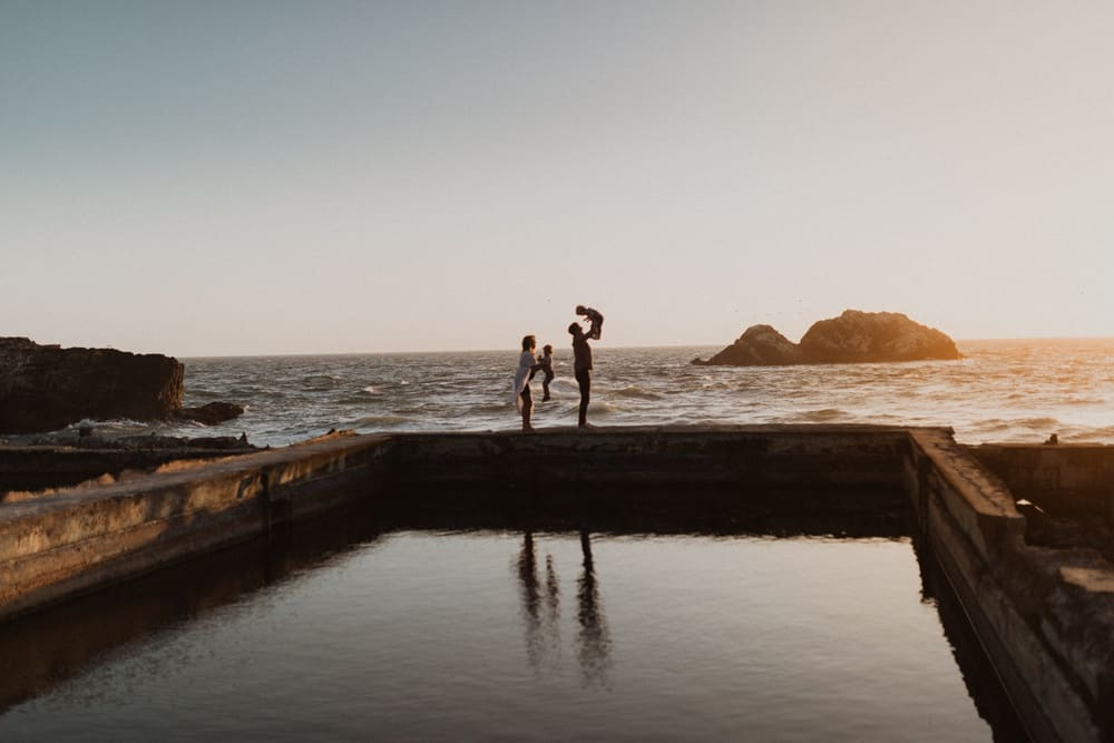 family at sutro bath at sunset for photography session