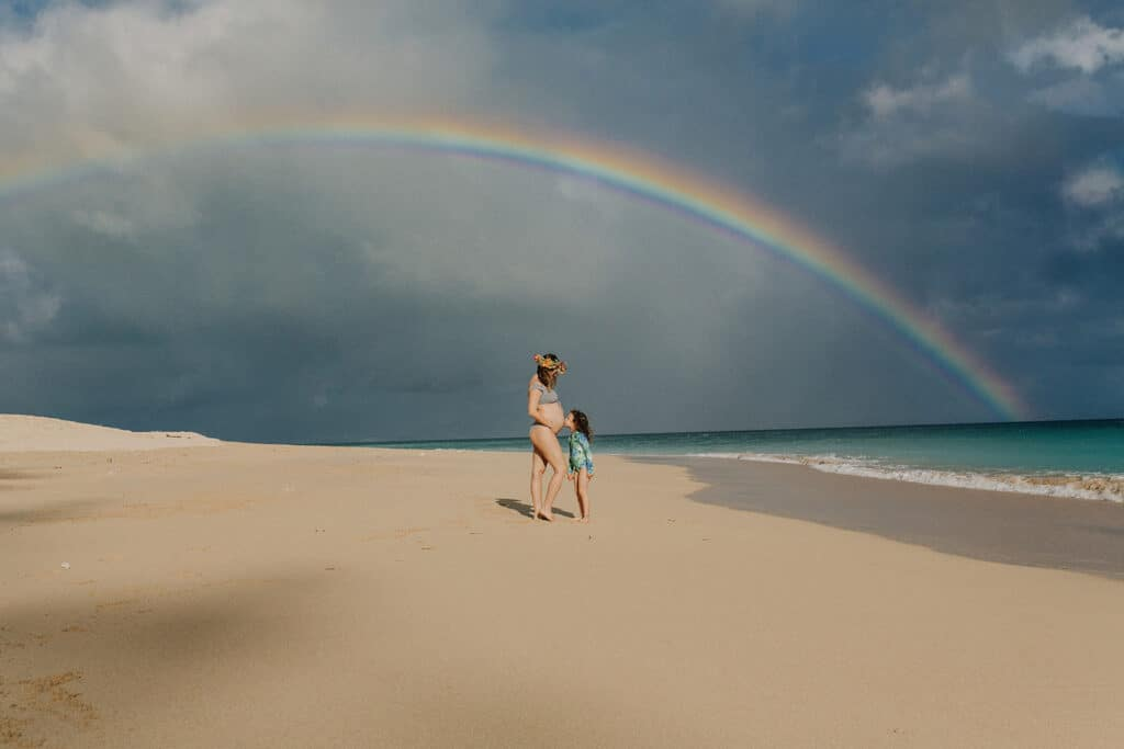 rainbow at baldwin beach during maternity photos in hawaii